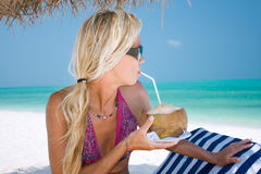 Beautiful blondy holding coconut Stock Images
