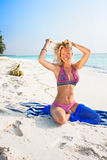 Beautiful blondy relaxing on tropical beach Stock Photos