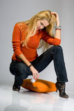 Beautiful blondy sitting on pillow and posing Royalty Free Stock Images