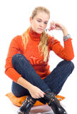 Beautiful blondy sitting on pillow and posing Royalty Free Stock Photography