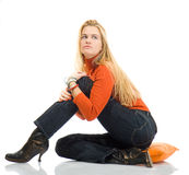 Beautiful blondy sitting on pillow and posing Stock Photography