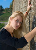 Beautiful blondy woman. Against on  old red brick wall Stock Photos