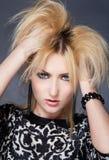 Beautiful blondy woman looks angry Stock Photo