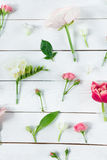 Beautiful blossoming flowers arrangement on wooden table Royalty Free Stock Images