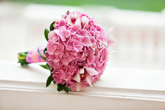 Beautiful blossoming pink hydrangea and orchids in weddin bouquet Stock Images