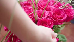 Beautiful blossoms of red roses. Making Bouquets of flowers close-up. Beautiful blossoms of red roses. Bouquet of flowers stock video