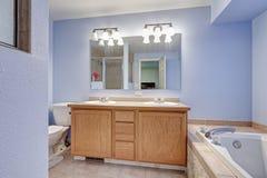 Beautiful blue bathroom with double vanity Stock Image