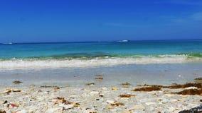 Beautiful blue beach low angle, Man crosses frame, 4K