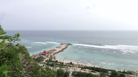 Beautiful blue beach panoramic ocean view, with clean water. View from the cliff. Tropical Bali island, Indonesia. stock video