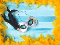 Blue carnival background with yellow feathers stock image