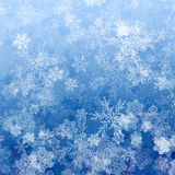Beautiful blue Christmas background with snowflakes Stock Image