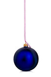 Beautiful blue Christmas ball hanging with pink ribbon on a white background. Stock Photos