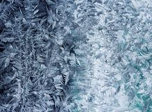 beautiful blue Christmas cold shiny frost pattern on glass winter clear morning royalty free stock photos
