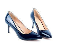 Beautiful blue classic women shoes isolated Stock Photos