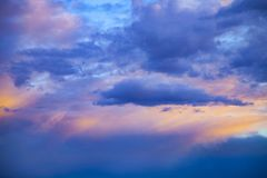 Beautiful blue cloudy sky at sunset royalty free stock photo