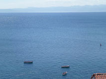 Beautiful blue color of Lake Ohrid on a sunny day as seen from Ohrid Old Town Royalty Free Stock Images