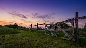 Beautiful blue-colored landscape, old wooden fence in the foreground Royalty Free Stock Image