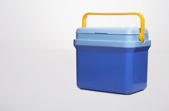 Beautiful  blue cooler with a. yelllow handle on Stock Photos