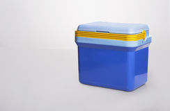 Beautiful  blue cooler with a. yelllow handle on Royalty Free Stock Photography