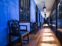 Beautiful blue corridor in old mansion. A corridor in the guest wing of the Blue Mansion, Cheong Fatt Tze, in Penang, Malaysia Stock Image