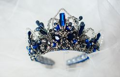 Beautiful blue crown on a grey background stock photos