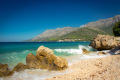 Beautiful blue dalmatian coast with sea waves Stock Photography