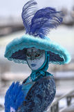 Beautiful Blue Disguise. Annecy, France- February 23, 2013:Environmental portrait of an unidentified person disguised in a beautiful blue costume in Annecy Stock Image