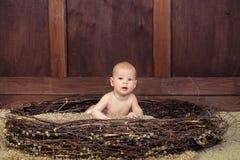 Beautiful blue-eyed baby lying Stock Images