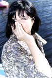 Beautiful blue-eyed brunette Stock Images