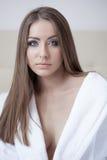Beautiful blue-eyed brunette posing at camera Royalty Free Stock Image