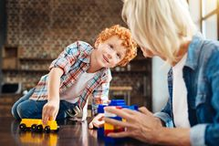 Beautiful blue eyed child looking at grandma while playing Stock Photo