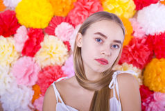 Beautiful blue-eyed girl on a colored background. Portrait of a beautiful blue-eyed blonde on a colored background Stock Photography