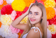 Beautiful blue-eyed girl on a colored background. Beautiful smiling blond woman on a bright color background Royalty Free Stock Photography