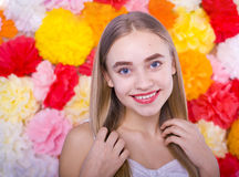 Beautiful blue-eyed girl on a colored background. Beautiful smiling blond woman on a bright color background Royalty Free Stock Images