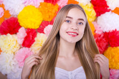 Beautiful blue-eyed girl on a colored background. Beautiful smiling blond woman on a bright color background Stock Photo