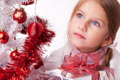 Beautiful blue-eyed girl dreaming of Christmas Stock Photos