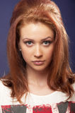 Beautiful blue eyed girl portrait. Portrait of Beautiful blue eyed girl with red hair looking at camera Royalty Free Stock Images