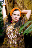 Beautiful blue-eyed woman with the african pigtails Royalty Free Stock Images