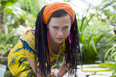 Beautiful blue-eyed woman with the african pigtails Royalty Free Stock Photos