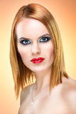 Beautiful blue-eyed woman with extreme makeup Stock Photography