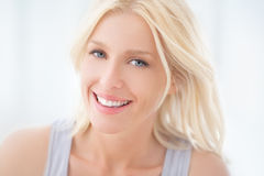 Beautiful Blue-Eyed Woman Smiling Stock Photo
