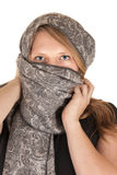 Beautiful blue eyed woman wearing a gray scarf Stock Image