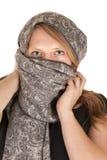 Beautiful blue eyed woman wearing a gray scarf Stock Image
