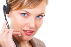 Beautiful blue eyes. The girl the operator with blue eyes Royalty Free Stock Photos