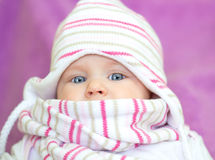 Beautiful blue eyes baby. Pretty Baby Girl With blue eyes in knit hat and scarf Royalty Free Stock Photo