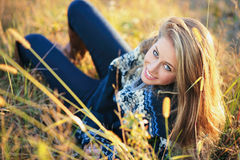 Beautiful blue eyes girl in a field Stock Images