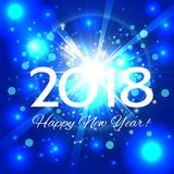 Beautiful blue fireworks with  greetings Happy New Year 2018! Stock Photos