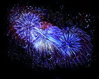 Beautiful blue fireworks in a night sky Royalty Free Stock Photos