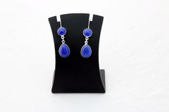 Beautiful blue gemstone silver ear rings. Jewelry Royalty Free Stock Photo