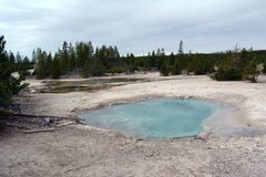 Beautiful Blue Geyser `Mystic spring` in Norris Geyser Basin in Park Yellowstone.  royalty free stock image